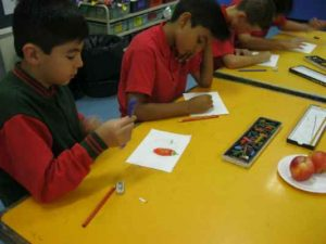 Grade 3 and 4 students exploring new techniques to create textured drawings.