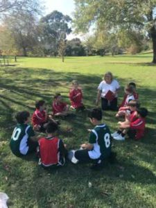 Ms Anstee givne one of our Boy's team a pep talk before the match